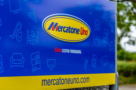 RUSSI (RA), ITALY - MAY 27, 2019: sunlight is enlightening and raindrops are covering the logo of Mercatone Uno on a gloomy day. Company went bankrupt last week Stock fotó - 124495461