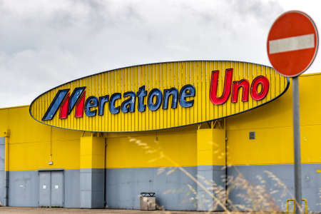 RUSSI (RA), ITALY - MAY 27, 2019: sunlight is enlightening logo of Mercatone Uno on storefront of closed store on a gloomy day. Company went bankrupt last week