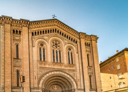 BOLOGNA, ITALY - MAY 10, 2019: sunlight is enlightening facade of the Catholic Church of The Sacred Heart of Jesus in Bologna