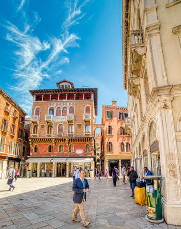 VENEZIA, ITALY – MAY 31, 2019: tourists walking and going for shopping in Campo San Luca, typical square of Venice