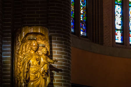 BOLOGNA, ITALY - MAY 10, 2019: sunlight is enlightening statue of The Blessed Virgin Mary holding Holy Child in the Catholic Church of The Sacred Heart of Jesus in Bologna Editorial