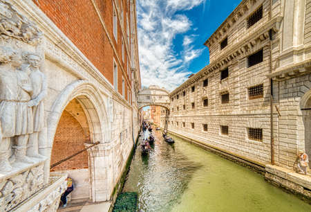VENEZIA, ITALY – MAY 31, 2019: tourists on gondolas passing in Rio di Palazzo  typical water channel of Venice, under the famous Bridge of Sighs