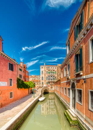 VENEZIA, ITALY – MAY 31, 2019: tourists visiting the city and enjoying the view of waters flowing in Rio di San Boldo, water channel of Venice along Fondamenta Del Parucheta