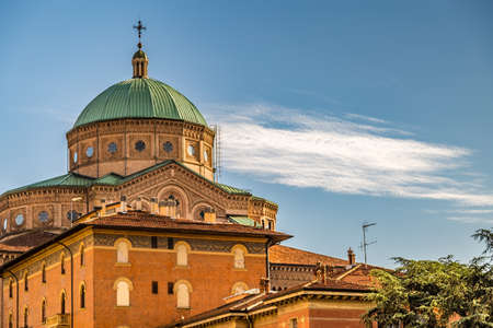 BOLOGNA, ITALY - MAY 10, 2019: sunlight is enlightening dome of the Catholic Church of The Sacred Heart of Jesus in Bologna