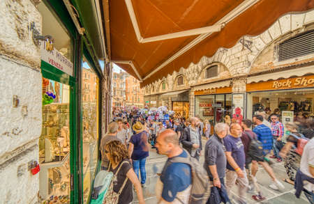 VENEZIA, ITALY – MAY 31, 2019: tourists walking and going for shopping in Salizzada Pio X, narrow street of the historical center of Venice