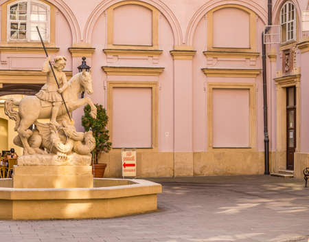 BRATISLAVA, SLOVAKIA - AUGUST 27, 2019: sunlight is enlightening Fountain of Saint George and the Dragon in The Primatial Palace in Bratislava, capital of Slovakia