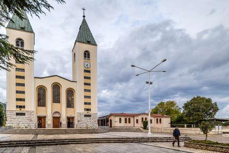 MEDUGORJE, BOSNIA AND HERZEGOVINA - NOVEMBER 3, 2019: pilgrims visiting St. James' Parish Church Redakční