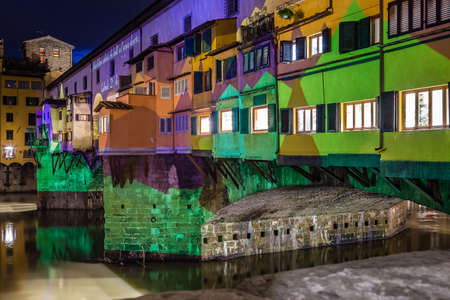 FLORENCE, ITALY - DECEMBER 15, 2019: Christmas projections dedicated to the moon enlightening the Ponte Vecchio, the Old Bridge of Florence in Tuscany in Italy
