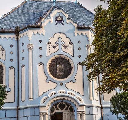 BRATISLAVA, SLOVAKIA - AUGUST 28, 2019: sunlight is enlightening Blue Church, Art Noveau building in Bratislava, capital city of Slovakia Archivio Fotografico - 136453332