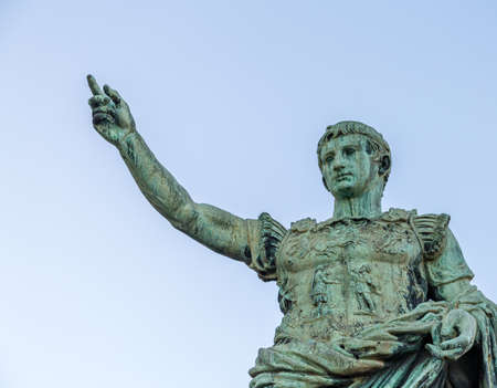 light is enlightening the Statue of Julius Caesar in Naples, Italy