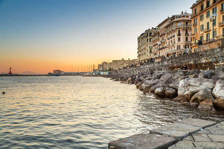 NAPLES, ITALY - JANUARY 2, 2020: people are walking on the promenade of Naples, Italy