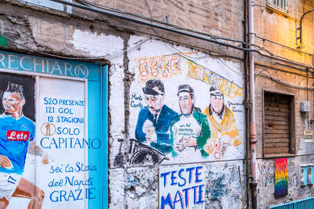 NAPLES, ITALY - JANUARY 4, 2020: light is enlightening street art dedicated to famous Italian comedians and football player
