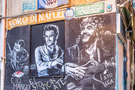 NAPLES, ITALY - JANUARY 4, 2020: light is enlightening street art dedicated to local celebrities Editoriali