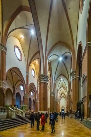 BOLOGNA, ITALY - DECEMBER 29, 2019: tourists visiting the Basilica of Saint Petronius