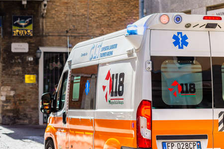 RAVENNA, ITALY - MAY 2, 2019: ambulance running in street of historical center