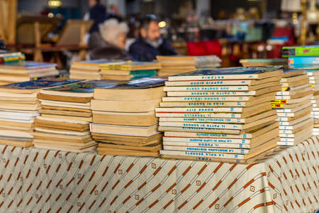 CESENA (FC) - FEBRUARY 16, 2020: lights are enlightening ancient and old books for sale at antiques fair