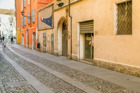 MODENA (MO), ITALY - FEBRUARY 15, 2019: people walking in the street of the historical center of Modena