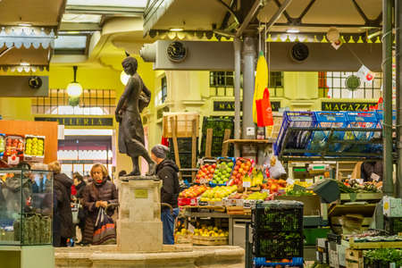 MODENA (MO), ITALY - FEBRUARY 15, 2019: people shopping in Albinelli covered market in the historical center of Modena Editorial