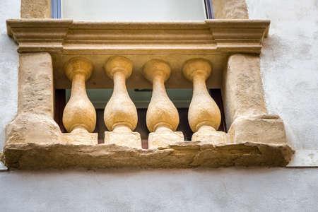window with amphoras in ancient building Banco de Imagens
