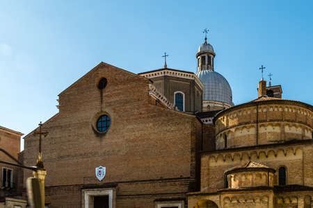PADOVA, ITALY - FEBRUARY 23, 2019: sunlight is enlightening the breathtaking Padua Cathedral dedicated to Assumption of the Virgin Mary Banco de Imagens