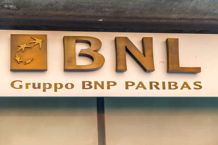 MODENA (MO), ITALY - FEBRUARY 15, 2019: sunlight is enlightening BNL BNP Paribas logo in agency in the historical center of Modena