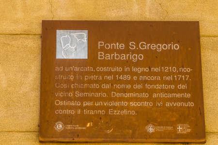 PADOVA, ITALY - FEBRUARY 23, 2019: sunlight is enlightening  San Gregorio Barbarigo sign in historical center in Padova