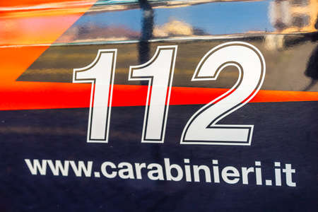 PADOVA, ITALY - FEBRUARY 23, 2019: sunlight is enlightening 112 Carabinieri sign on car in historical center in Padova