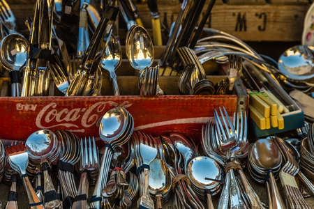 PADOVA, ITALY - FEBRUARY 23, 2019: sunlight is enlightening cutlery for sale in market in Padua