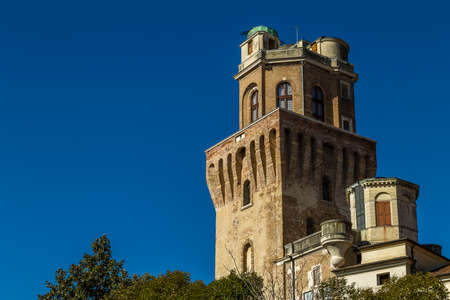 PADOVA, ITALY - FEBRUARY 23, 2019: sunlight is enlightening the tower of Museum La Specola,Museum of Astronomical Observatory of Padua