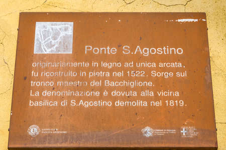 PADOVA, ITALY - FEBRUARY 23, 2019: sunlight is enlightening Saint Agostino bridge sign in historical center in Padova