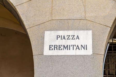 PADOVA, ITALY - FEBRUARY 23, 2019: sunlight is enlightening Ermitani Square  sign in historical center in Padova