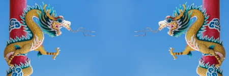 Twin Chinese Dragon statue on blue sky background  photo
