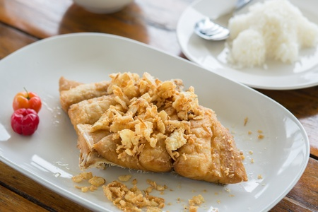 Fried fish with Garlic  usually eat with chili sauce and rice  photo