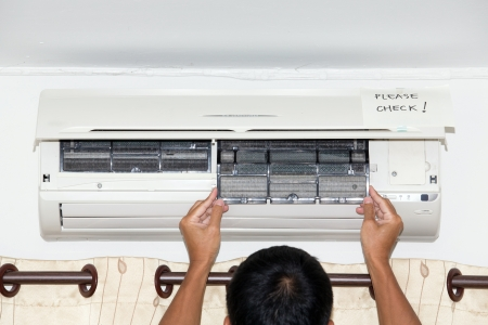 hands in the air: Checking air condition filter