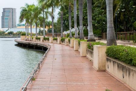 walkway beside the lake in Bangkok public park photo