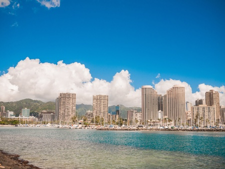 HONOLULU, HAWAII - FEB 2, View of Waikiki Yacht club from Ala Moana beach park with buildings behind  photo