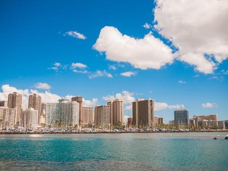 HONOLULU, HAWAII - FEB 2, View of Waikiki Yacht club from Ala Moana beach park with buildings behind