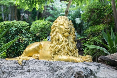 Yellow lion statue in garden photo