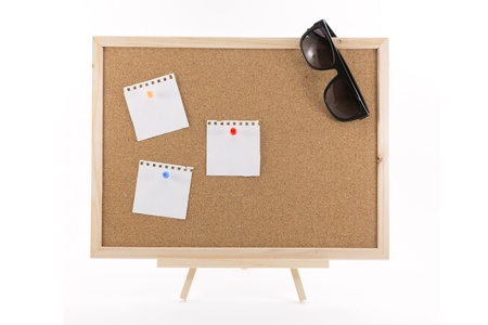 cork board with three white note and sunglasses  photo