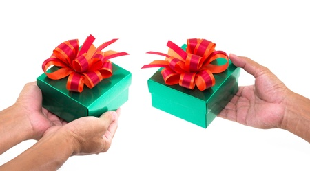 Green gift box with red and orange satin bow on hand  photo