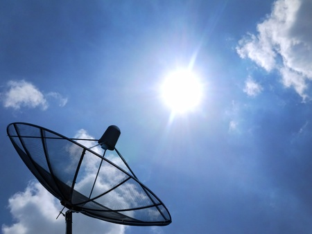 super highway: Satellite disc in blue sky Stock Photo
