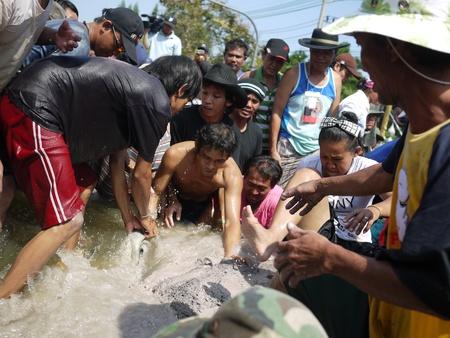 wade: BANGKOK, THAILAND - November 17 - Thai flood hits Central of Thailand, victims tear down a dam  To reduce the water level  on November 17, 2011 in Bangkok, Thailand  Editorial