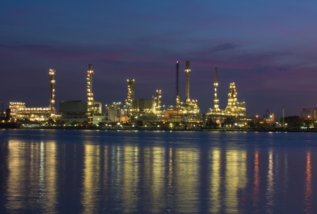 Petroleum oil refinery beside the river at twilight photo