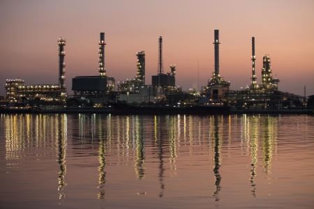 Petroleum oil refinery beside the river at night