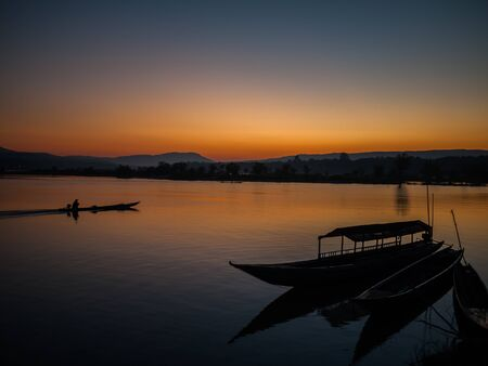 silhouette of fishing boat in Mekong river  photo