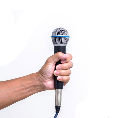 Man hand holding  microphone isolated on white background photo