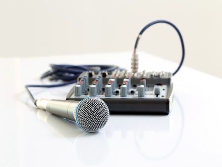 Microphone and mixer on white table photo