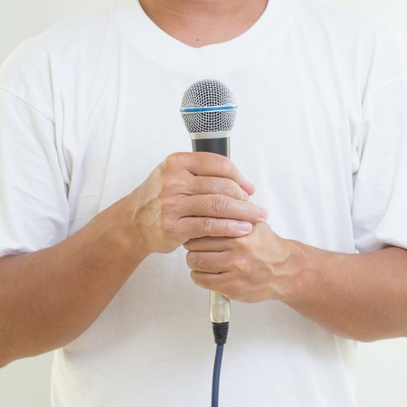 Man hand holding  microphone photo