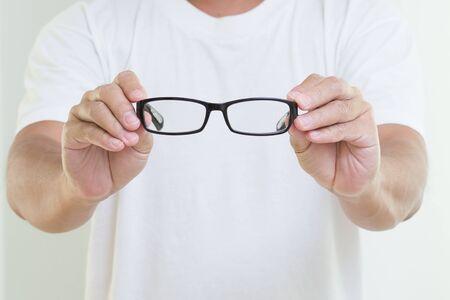 bifocals: Man hands holding eyeglasses
