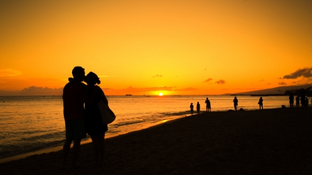 Silhouette of couple in love kissing at sunset photo